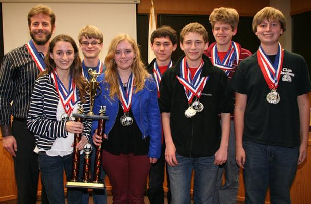 The+AcaDeca+Red+team+poses+for+a+photo+with+their+awards.