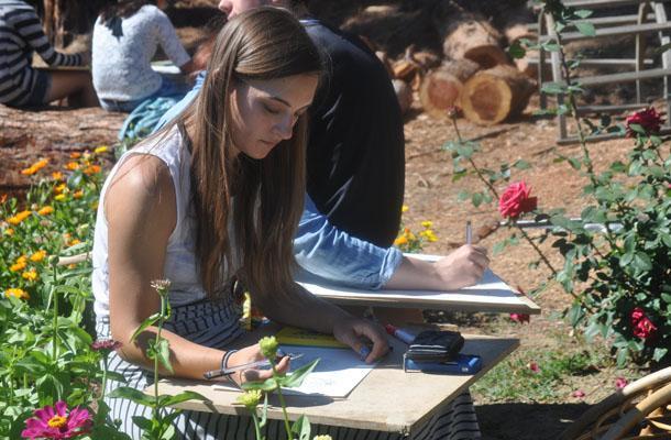 Senior+Silvana+Moiceanu+draws+in+the+Campo+Garden.+
