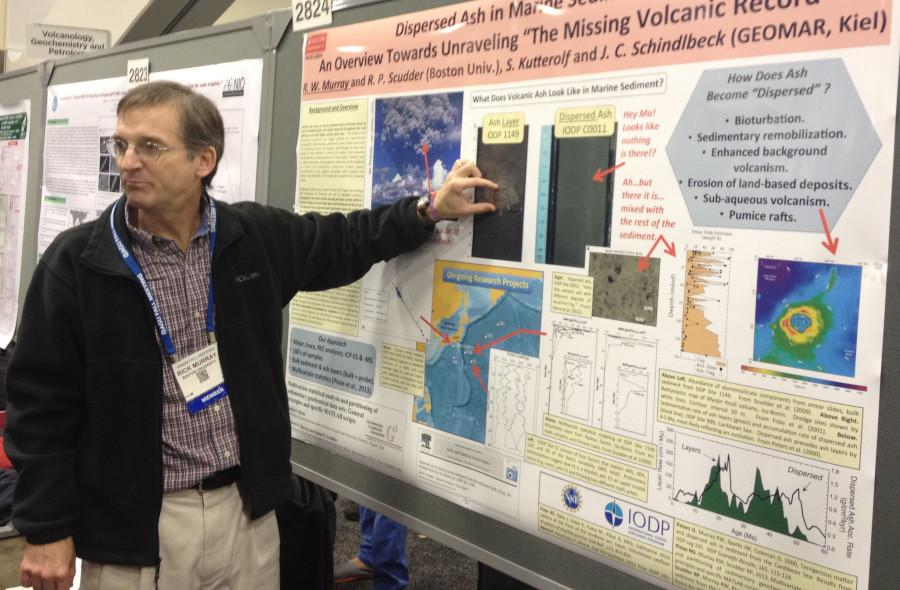 A+professor+from+the+AGU+Conference+explains+his+poster+to+a+group+of+students.