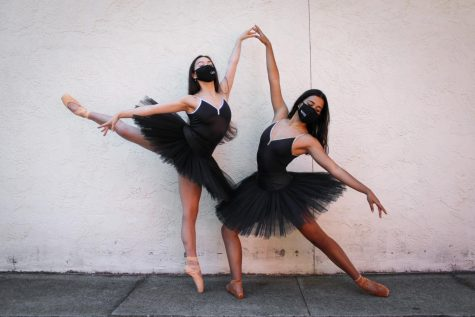 Juniors Halley Campo and Olivia Curtis symbolically represent the despair felt by dancers during the pandemic due to being inhibited from practicing their art form.