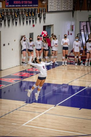 Olivia Woo jumps in the serve