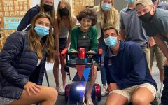 Leadership students pose with Ms. Danielli and her newly gifted scooter.