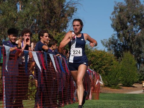 Sophomore Daisy Penny pushes through the final stretch to earn a spot in top 5 Frosh Soph girls.