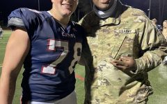 Elijah Klock and former Campo student Matai Bell pose together during the Homecoming game.