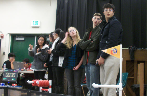 Seniors+Laura+Gustafson+and+Matthew+Stickle%2C+and+sophomore+Koroush+Arastah+check+out+the+competition+at+last+weekends+tournament