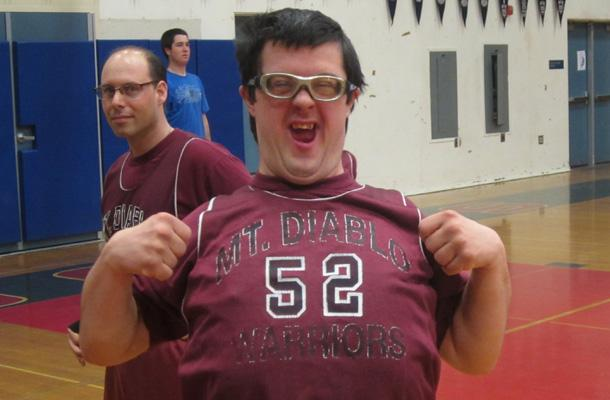 A Special Olympics player celebrates after making a basket.