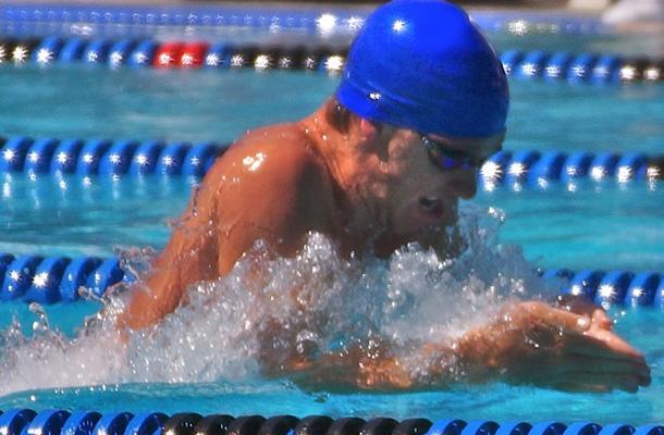 Senior Steven Stumph swims breaststroke. Stumph broke the National High School REcord in the 100 yard breaststroke on May 18.