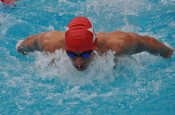 Sophomore Derek Ludwig completes his second lap of Butterfly in the medley race.