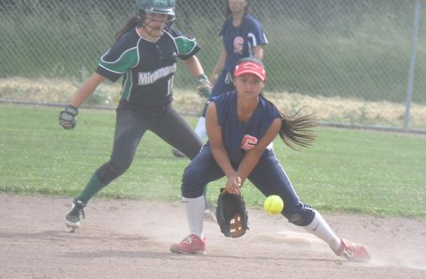 Junior and shortstop Dani Thomas tries to get a force out at second.