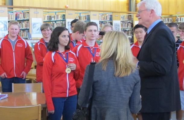The Academic Decathlon team listens to a congratulatory speech from Congressman George Miller.