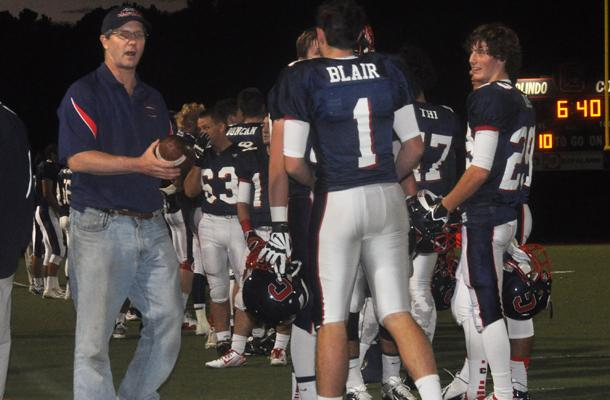Junior kicker Matt Blair talks to a coach during Campo's 38-28 victory over Las Lomas.