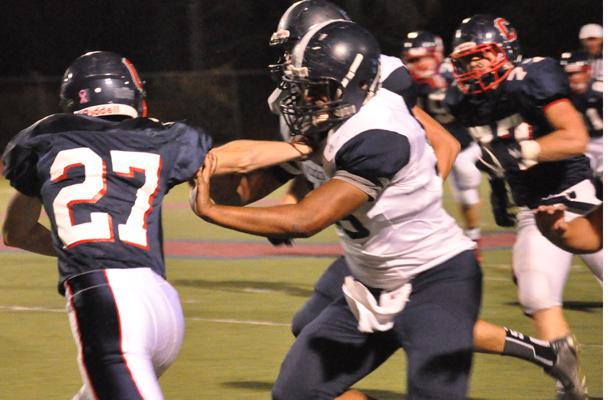 Junior Jonathan Hughes stiff arms a Dougherty Valley defender in their 42-26 victory on Thursday night.