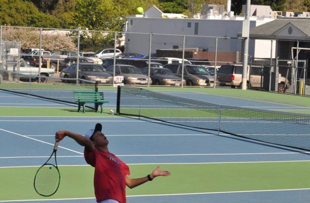 Singles+Player+Seren+Tochikara+serves+a+ball+towards+his+opponent.+Seren+goes+on+to+win+his+match.