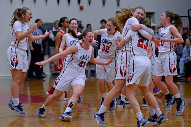 The Campolindo girls varsity basketball team celebrate their win over St. Mary's during their NorCal Division III girls basketball championship game at Campolindo High School in Moraga, Calif. on Saturday, March 18, 2017. Campolindo defeated St. Mary's 78-56. (Jose Carlos Fajardo/Bay Area News Group)
