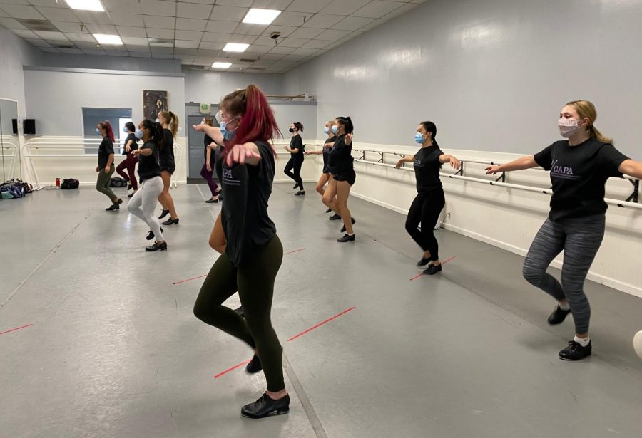 Students at the California Academy of Performing Arts (CAPA) tap dance while staying 6 feet apart and wearing masks. Dance studios have been making a return to regular scheduling by ensuring COVID-19 safety guidelines for students in class.  Photography by Caroline Fitzpatrick