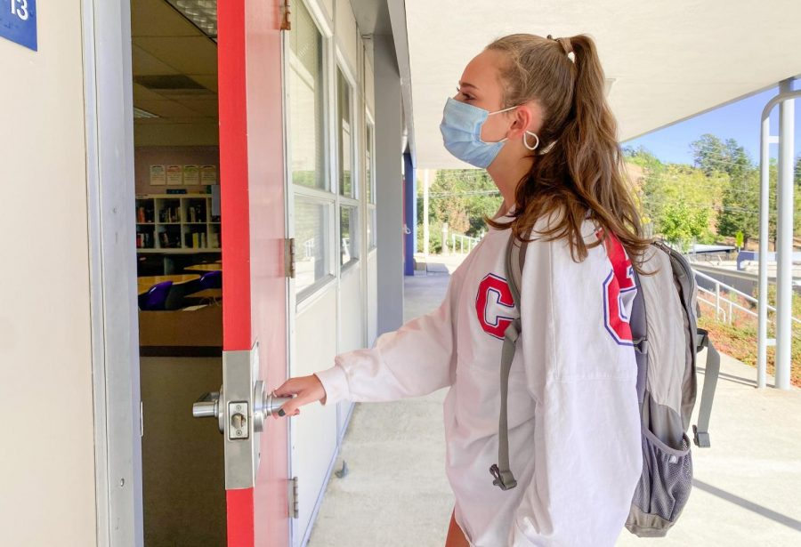 Junior Alissa Flett enters a classroom wearing a protective mask. The AUHSD is currently making decisions over whether students should be returning to schools during COVID-19.
