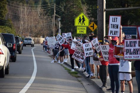 Student athletes rally for the reopening of sports practices during the pandemic in front of Campolindo Highschool.