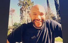 Stephen Bishop smiles in his backyard while Zooming with the Campo community.