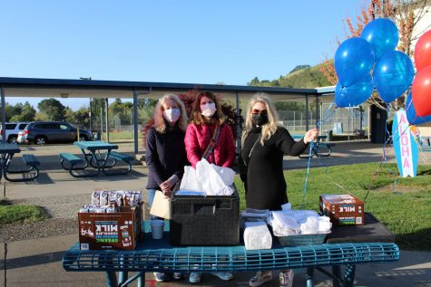 Campo moms pass out breakfast and chocolate milk to seniors.