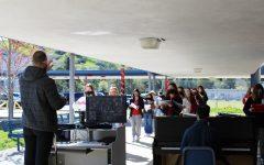 Choir teacher Mark Roberts leads the Campo choir in a socially distant, outdoor rehearsal.