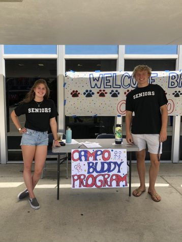 Seniors Regan Stambaugh and Cooper Lenahan encourage students to join the Campo Buddy Program at Club Day.