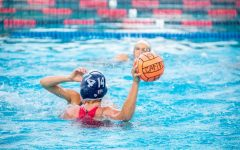 Junior Kaia Levenfeld (14) throws the ball after the defensive stop.