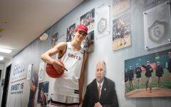 Senior Aidan Mahaney poses with head coach and close friend Randy Bennett in the Saint Mary's basketball hallway.